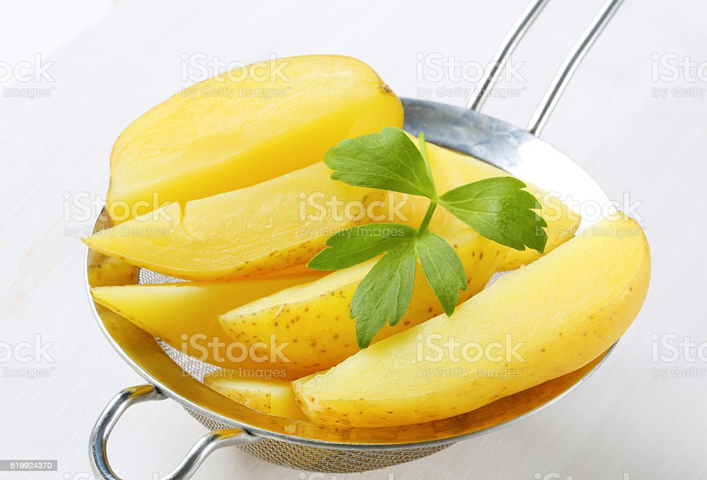 Boiled potatoes in a colander stock photo