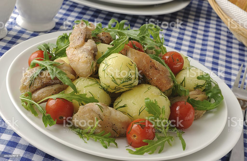 Boiled potatoes with chicken and tomato royalty-free stock photo