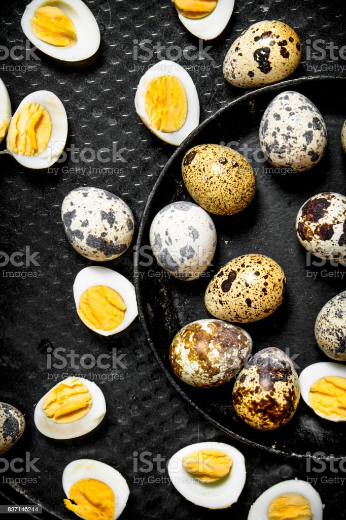 Boiled quail eggs on plate . stock photo