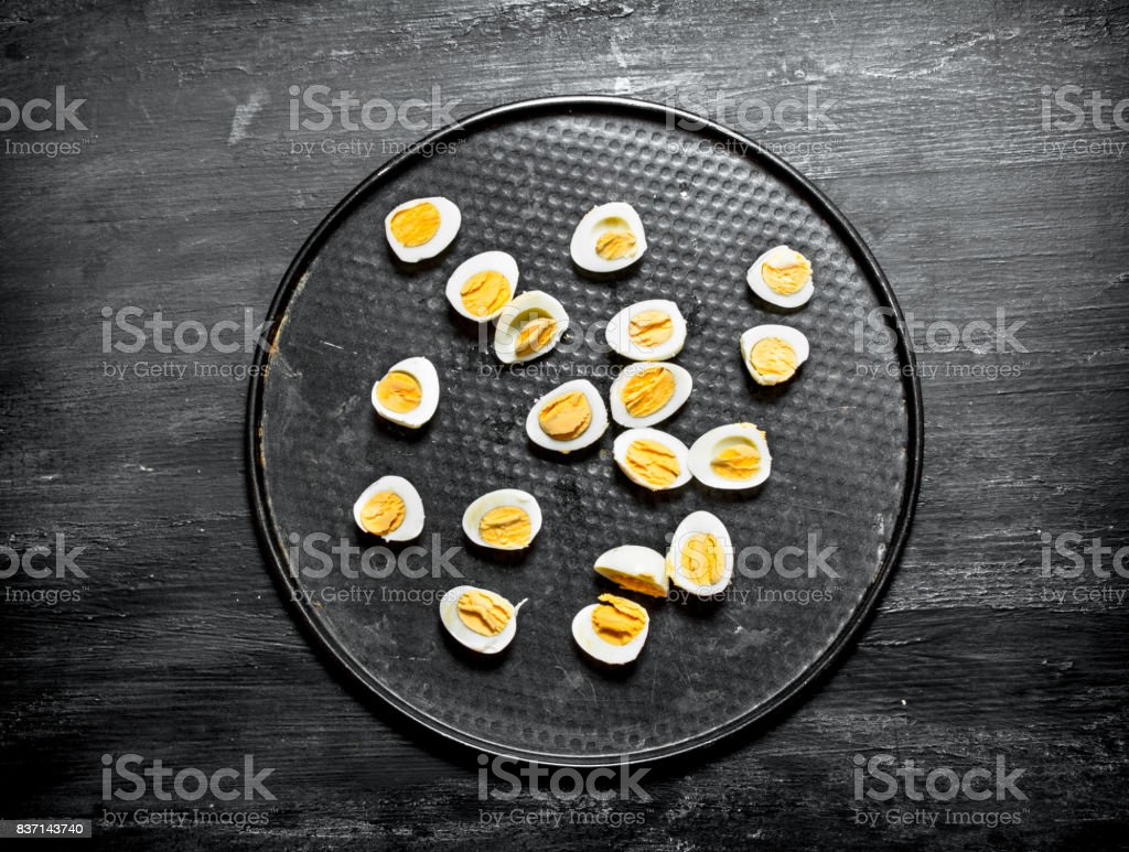 Boiled quail eggs on the plate. stock photo