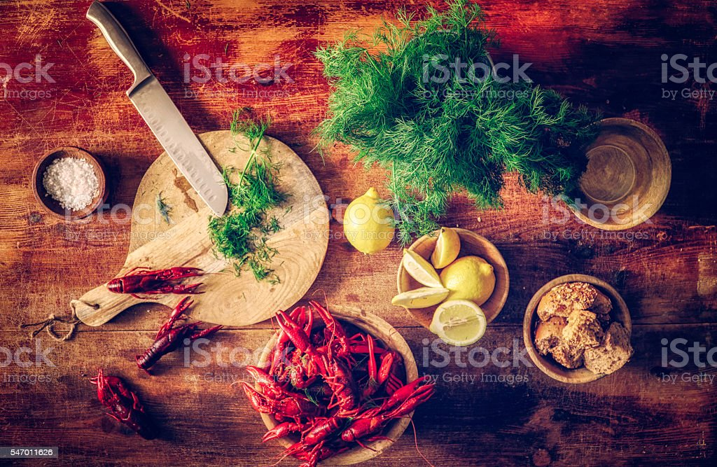 Boiled Red Crayfish with Fresh Dill and Lemon stock photo