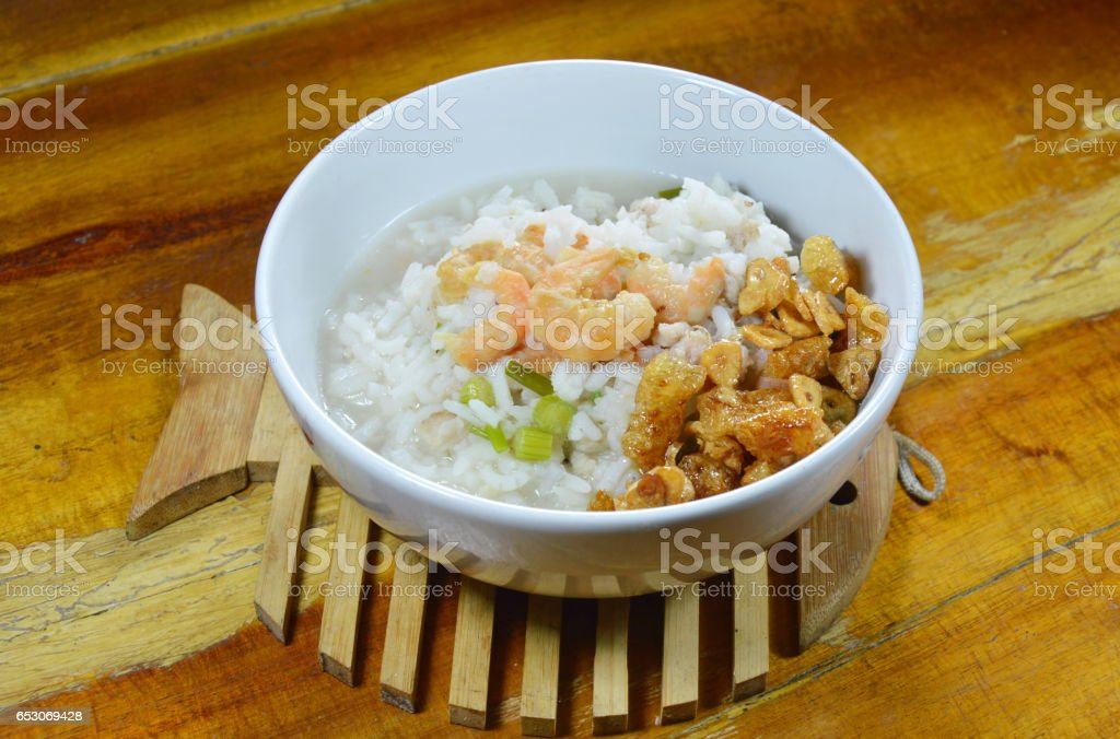 boiled rice with minced pork and dried shrimp topping fried garlic stock photo