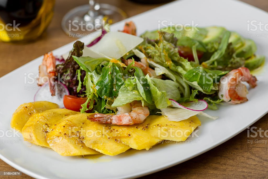 boiled shrimp, pineapple, avocado, lettuce, arugula, tomatoes and radishes stock photo