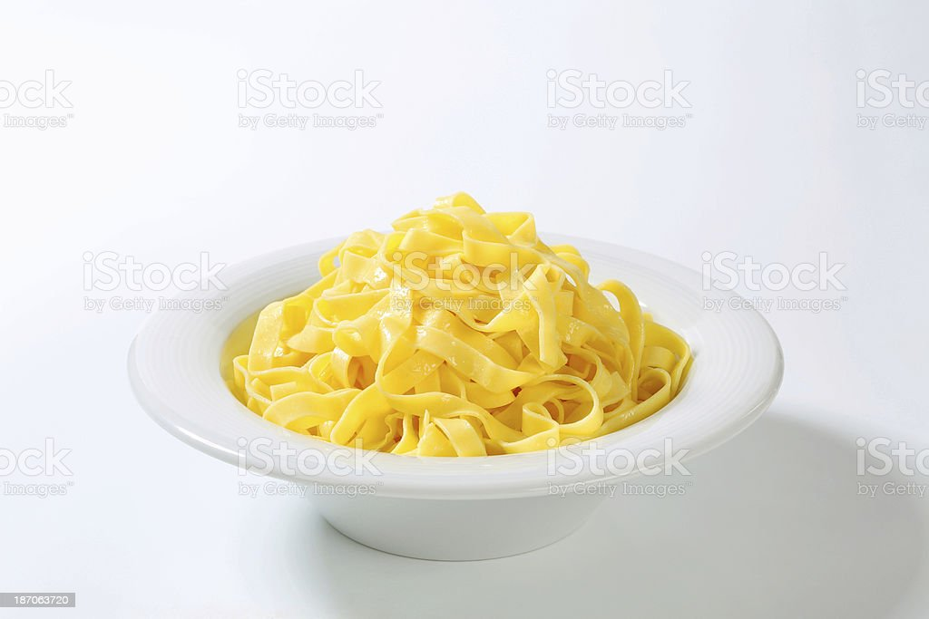 Boiled tagliatelle in a plate royalty-free stock photo