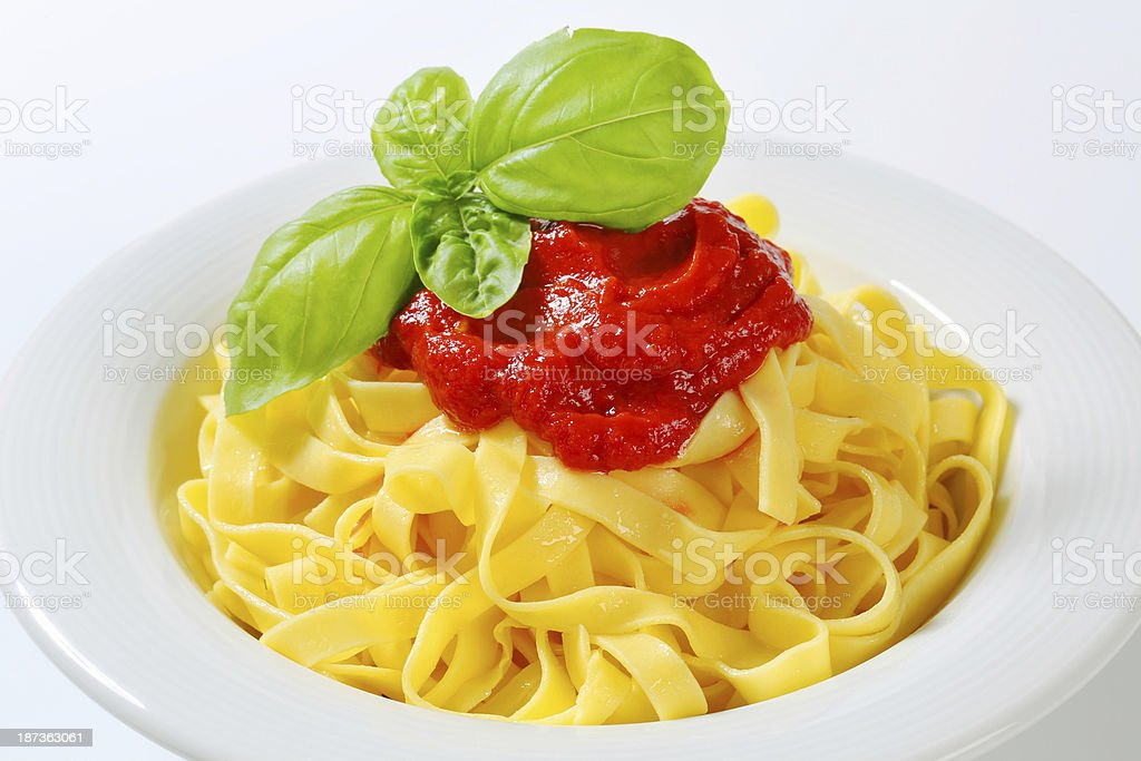 Boiled tagliatelle with tomato sauce royalty-free stock photo