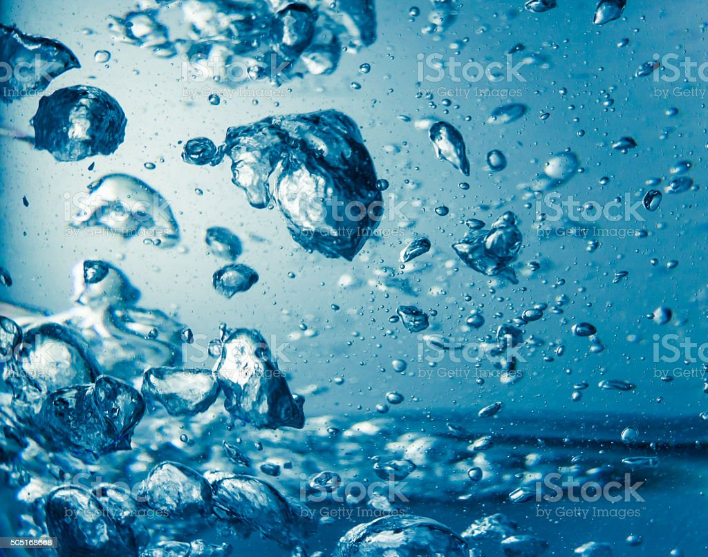 Boiled water with bubbles stock photo