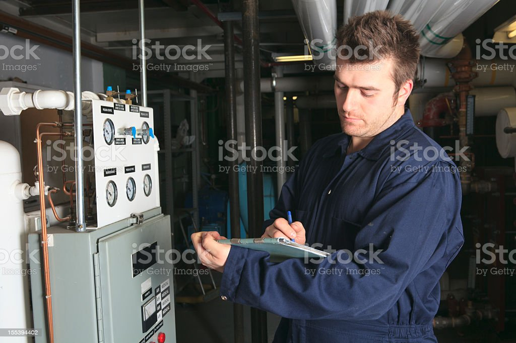 Boiler Room - Employee Take Note stock photo
