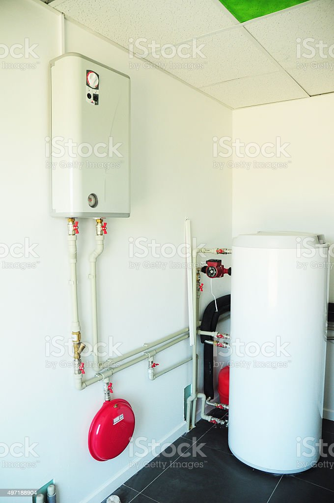 Boiler room with a new gas boiler stock photo