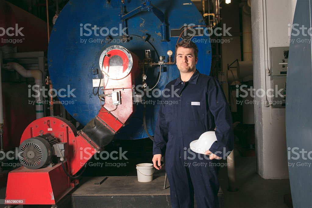Boiler Room - Worker Holding Helmet stock photo