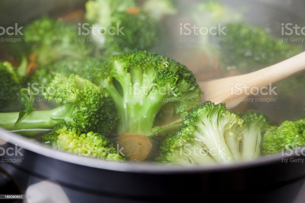 Boiling broccoli and carrots stock photo