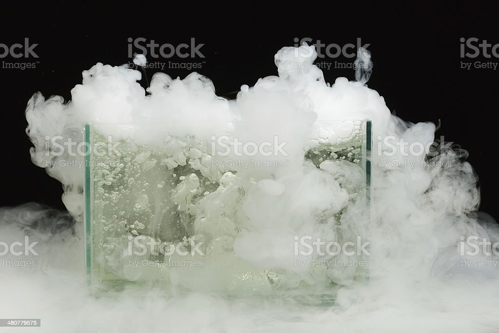 boiling dry ice with vapor stock photo