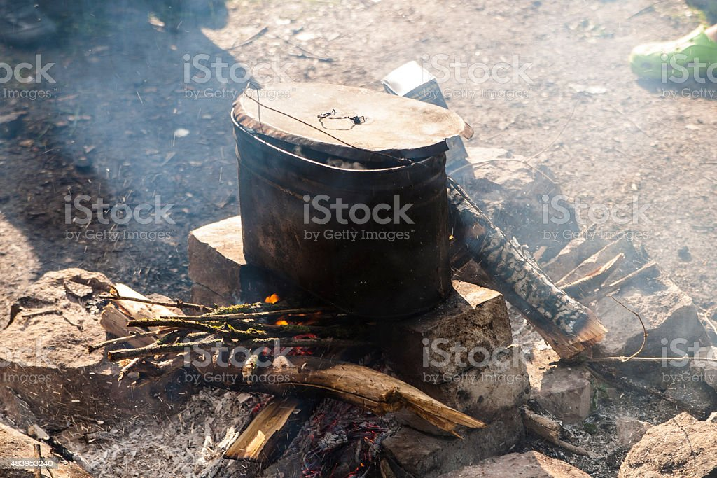 Boiling pot at the campfire royalty-free stock photo