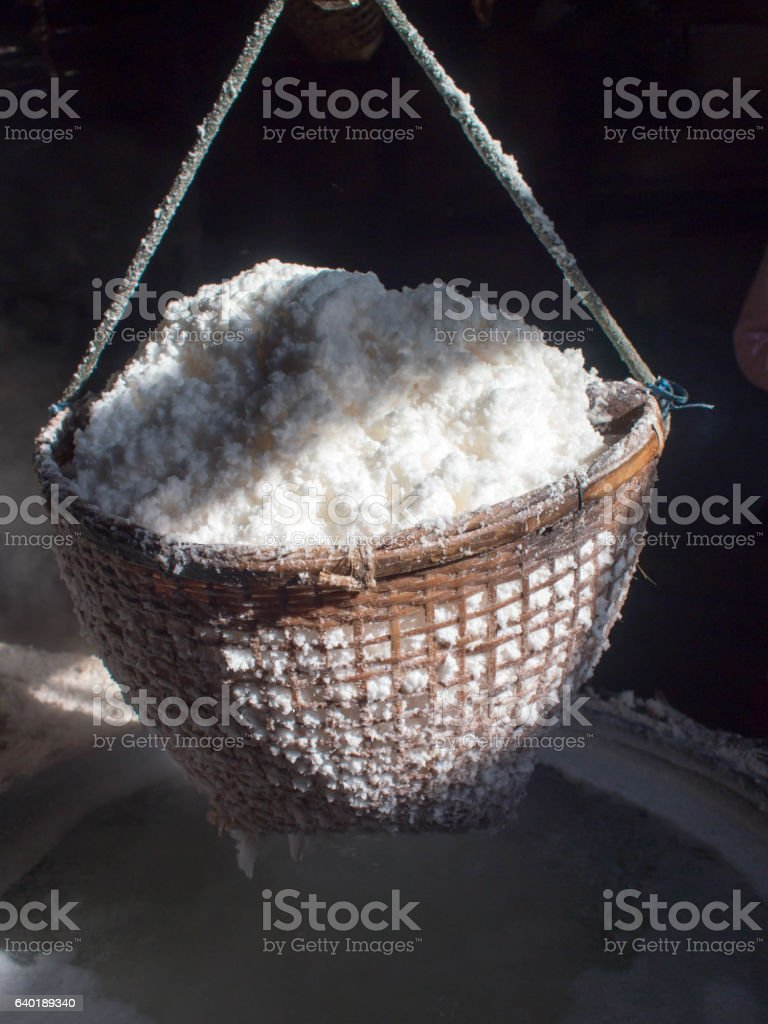 Boiling rock salt, crystallized salt from boiled saltwater to dr stock photo