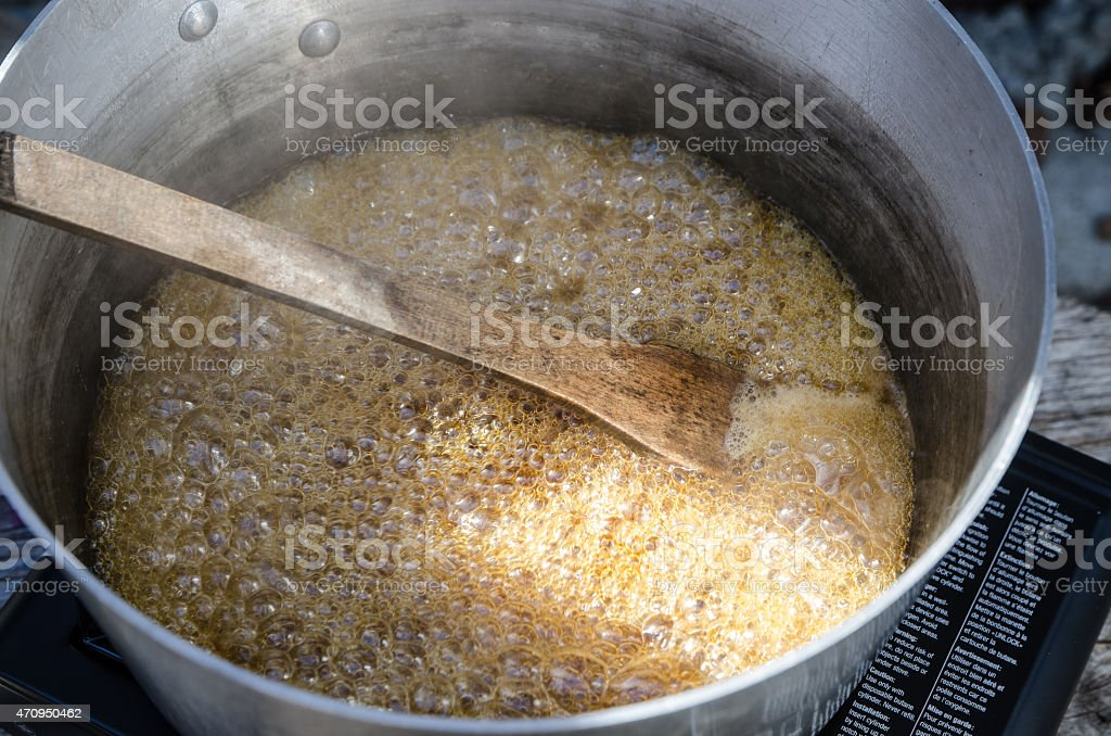 Boiling the syrup stock photo