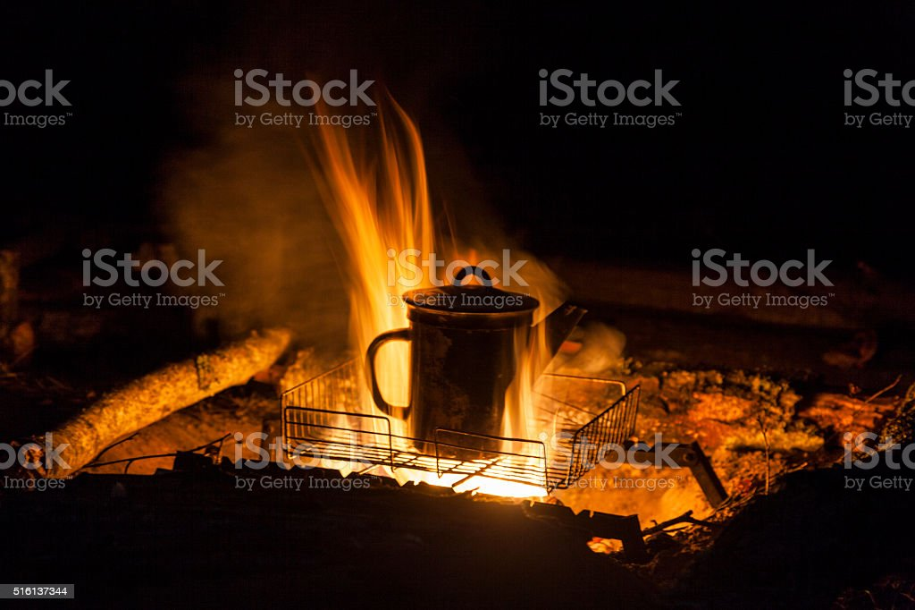 Boiling water in the pot on fire stock photo