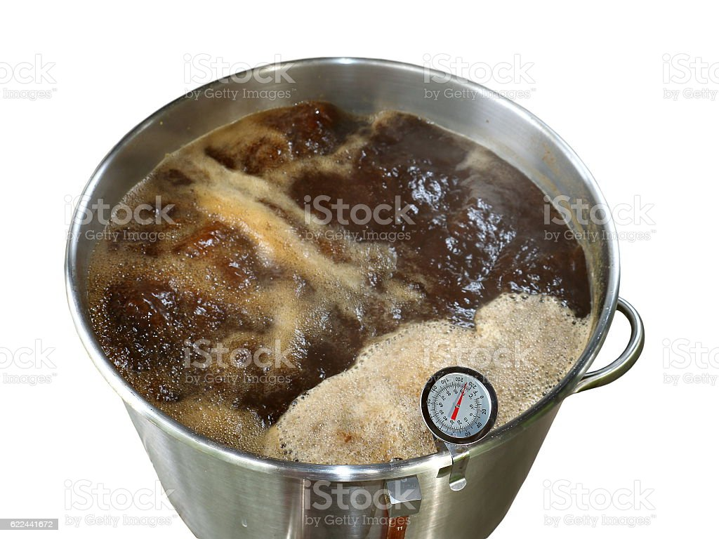 Boiling Wort for Home Brewed Brown Ale on White Background stock photo