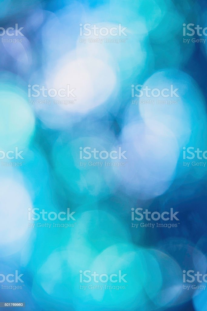 Bokeh background in teal, blue and purple stock photo
