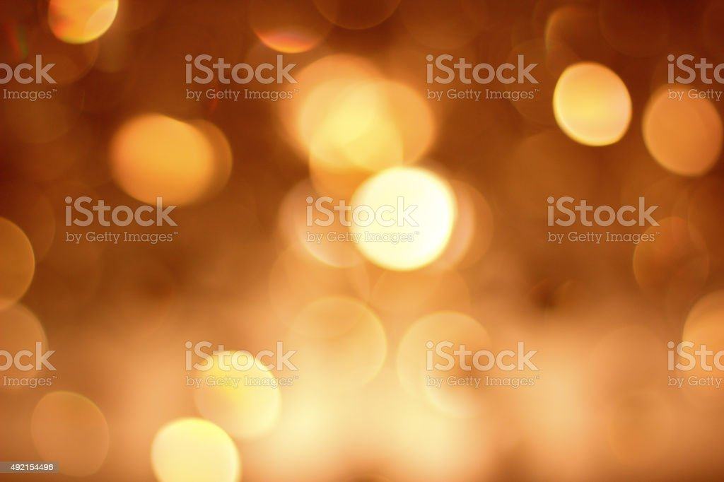 bokeh defocused light golden background stock photo