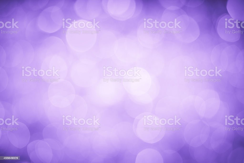 Bokeh display of blurred lighting on a purple background stock photo