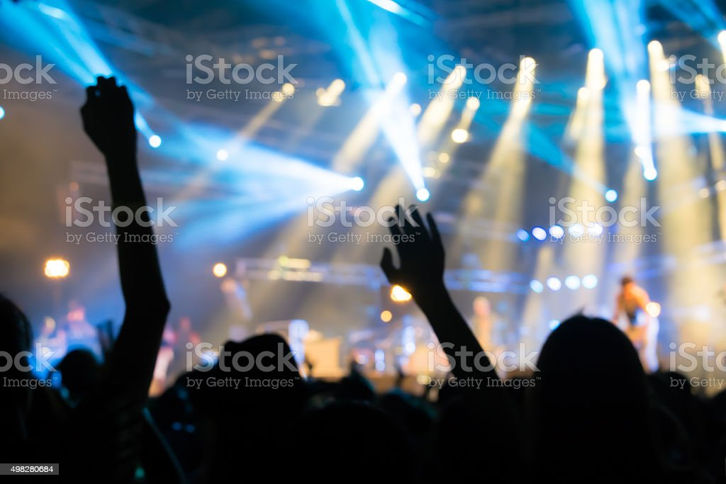 Bokeh lighting in outdoor concert with cheering audience stock photo