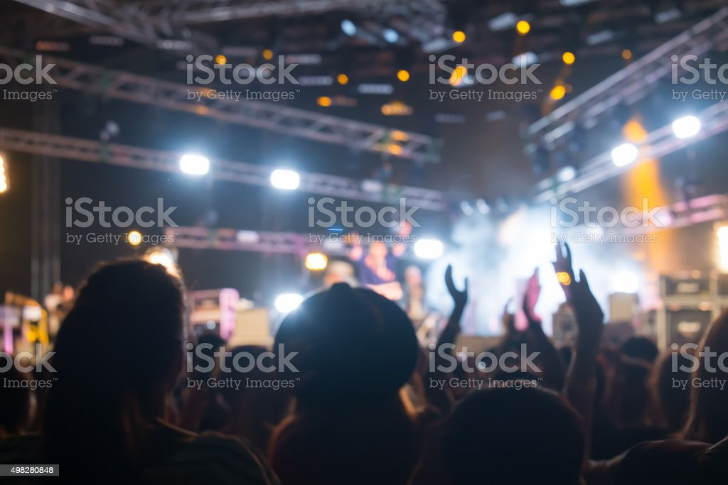 Bokeh lighting in outdoor concert with cheering audience stock photo