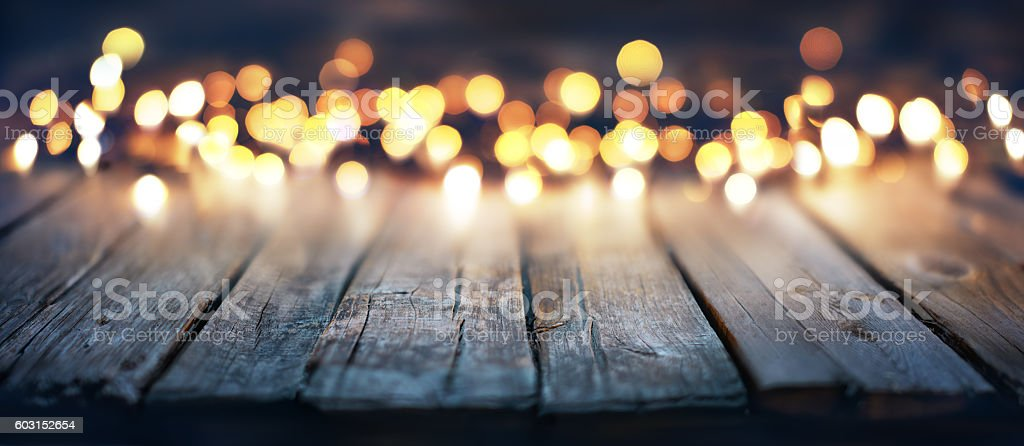 Bokeh Of Christmas Lights On Vintage Wood stock photo