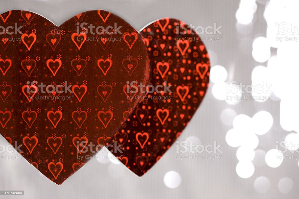Bokeh of Lights with Two Hanging Valentines Hearts, Copy Space royalty-free stock photo