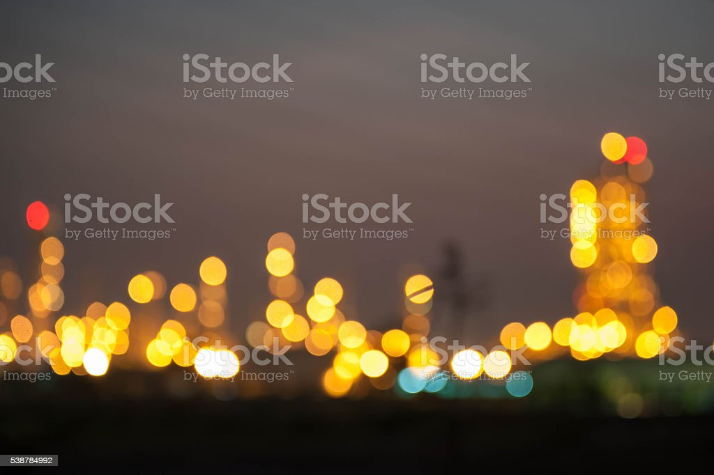 Bokeh of Oil Refinery Illuminated at Night stock photo