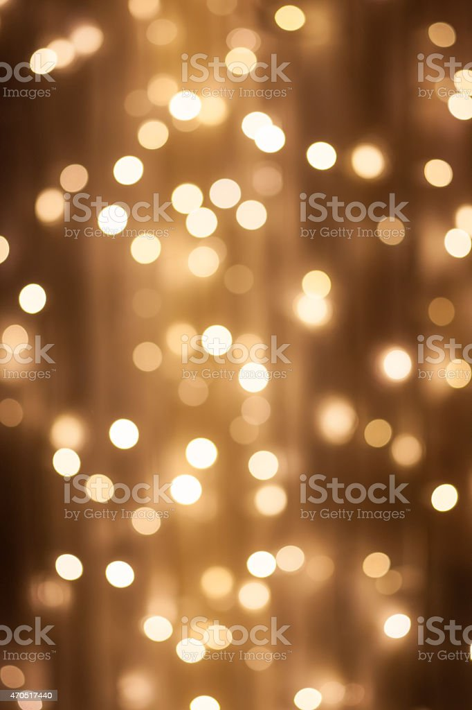A bokeh picture of yellow/white lights stock photo