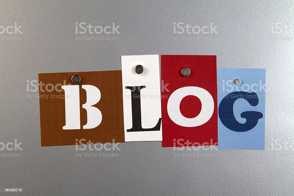 Bold letters spelling blog pinned on a silver magnet wall royalty-free stock photo