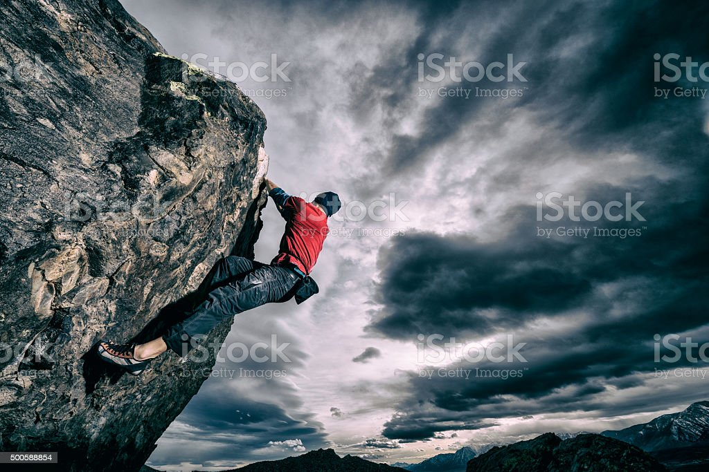 bold rock climber outside stock photo