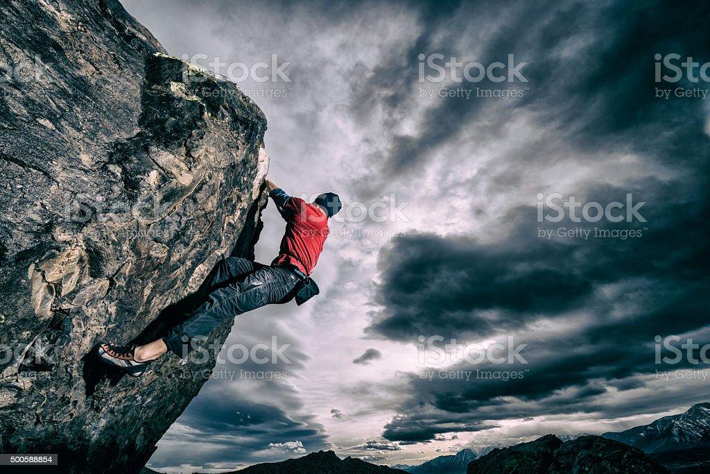 bold rock climber outside stock photo