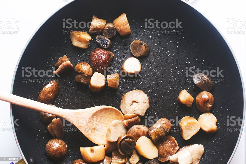 boletus mushrooms fried in a pan stock photo