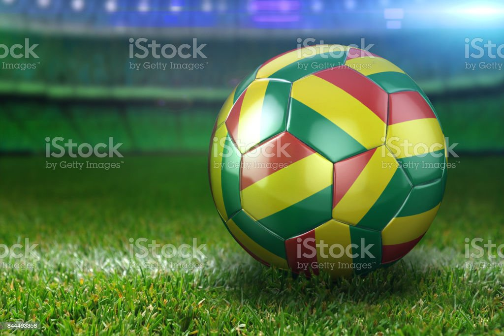 Bolivia Soccer Ball on Stadium Green Grasses at Night stock photo