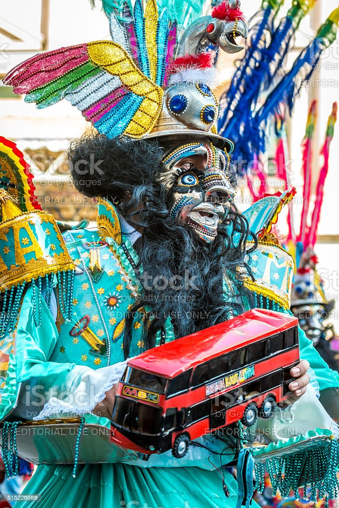 Bolivian Dance of Devils with a bus stock photo