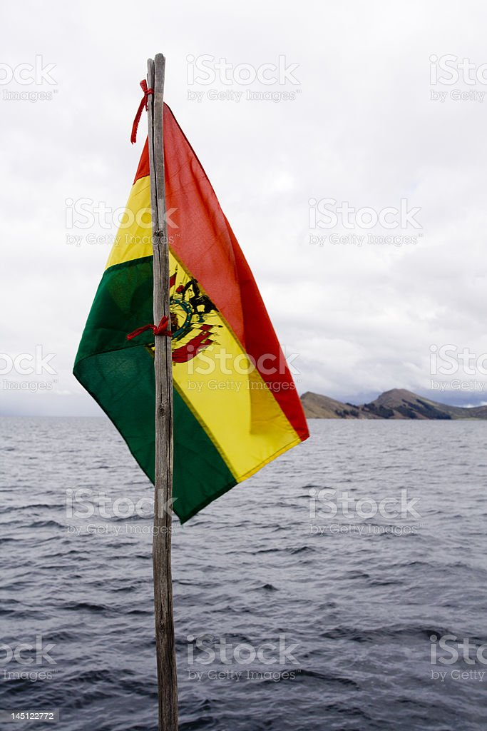 bolivian flag and titicaca lake stock photo