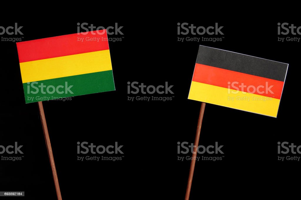 Bolivian flag with German flag isolated on black background stock photo