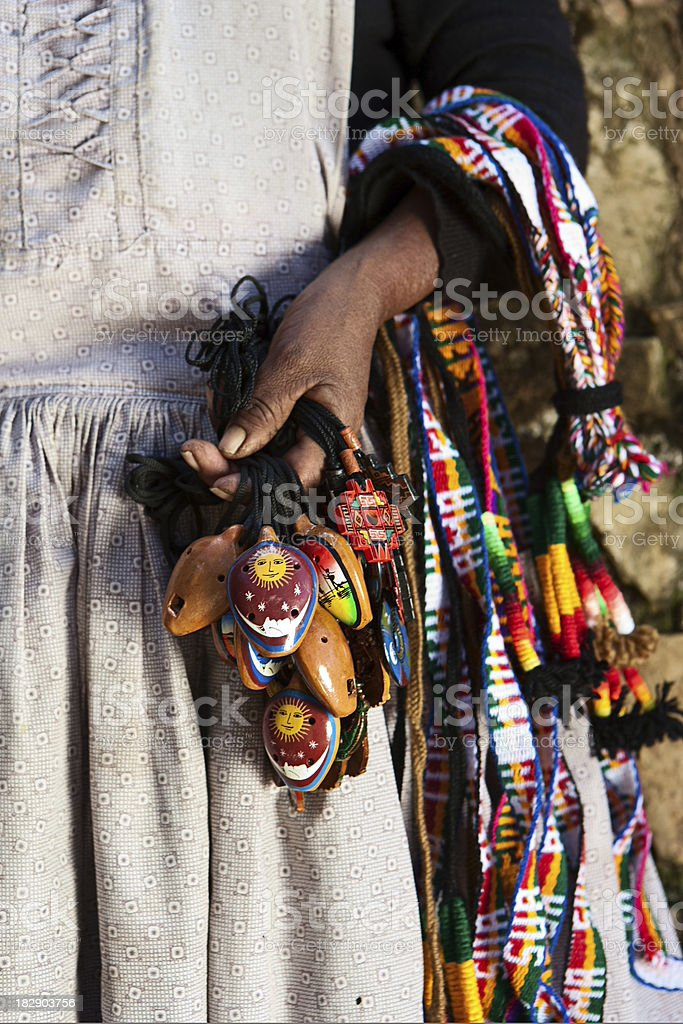 Bolivian woman selling souvenirs, Isla del Sol, Bolivia royalty-free stock photo