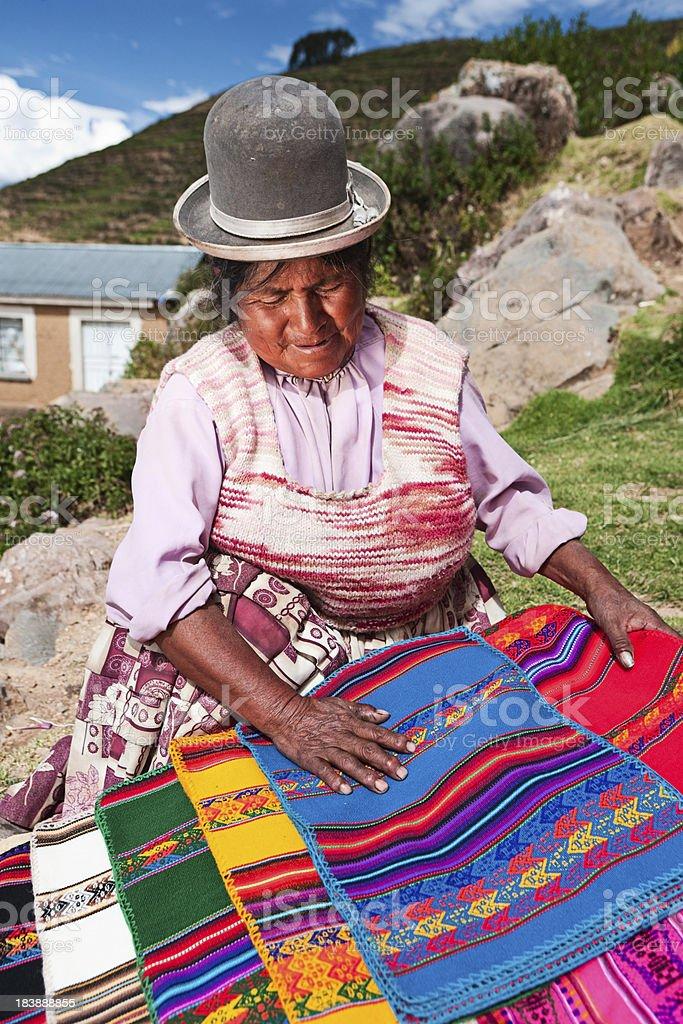 Bolivian woman selling souvenirs, Isla del Sol, Bolivia royalty-free stock photo