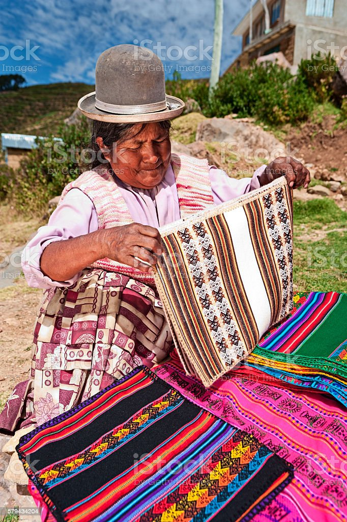 Bolivian woman selling souvenirs, Isla del Sol, Bolivia stock photo