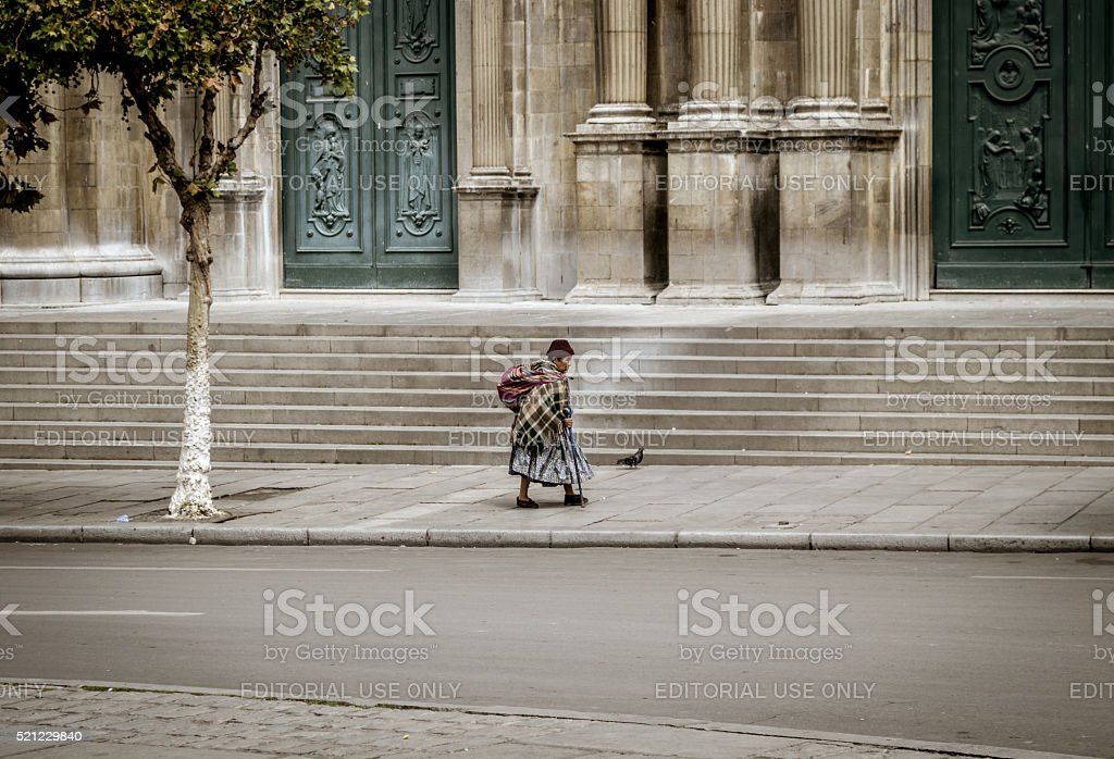 Bolivian woman walking in La Paz stock photo