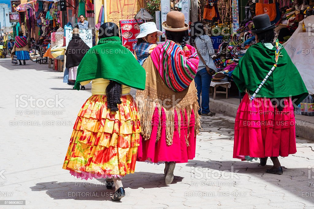 Bolivian  women in traditional clothes on the street stock photo