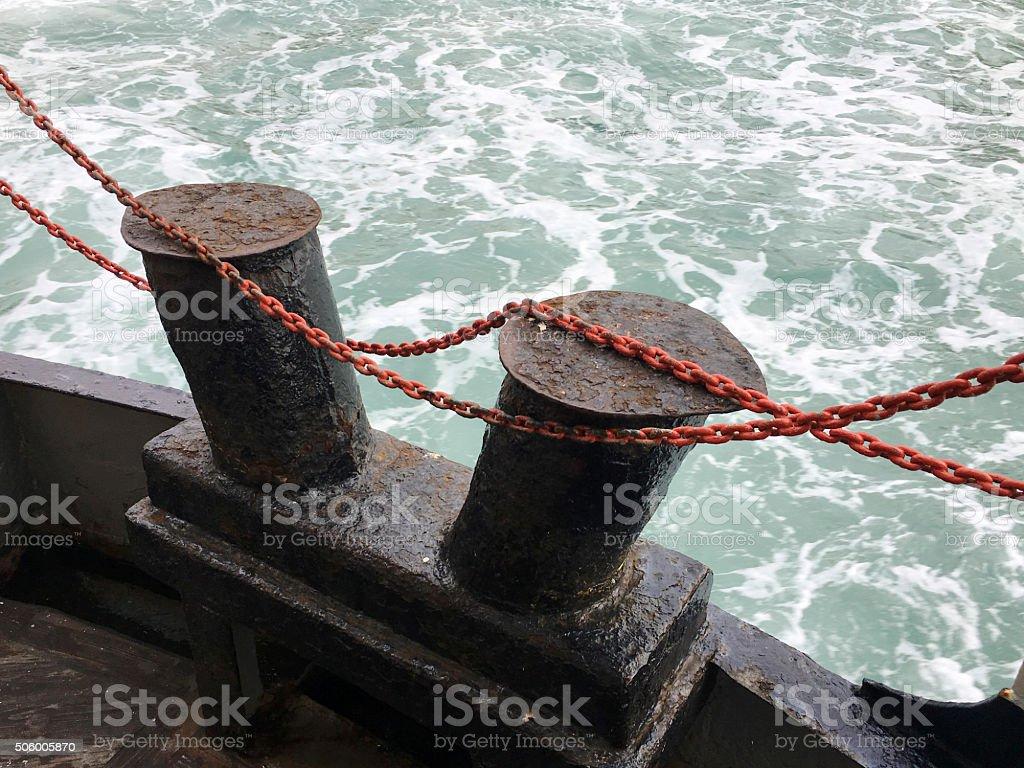 Bollard and chain on passenger ship stock photo