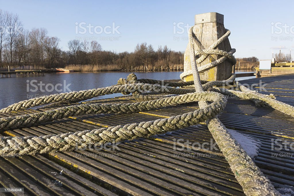 Bollard and rope in the harbor of Lauwersoog stock photo