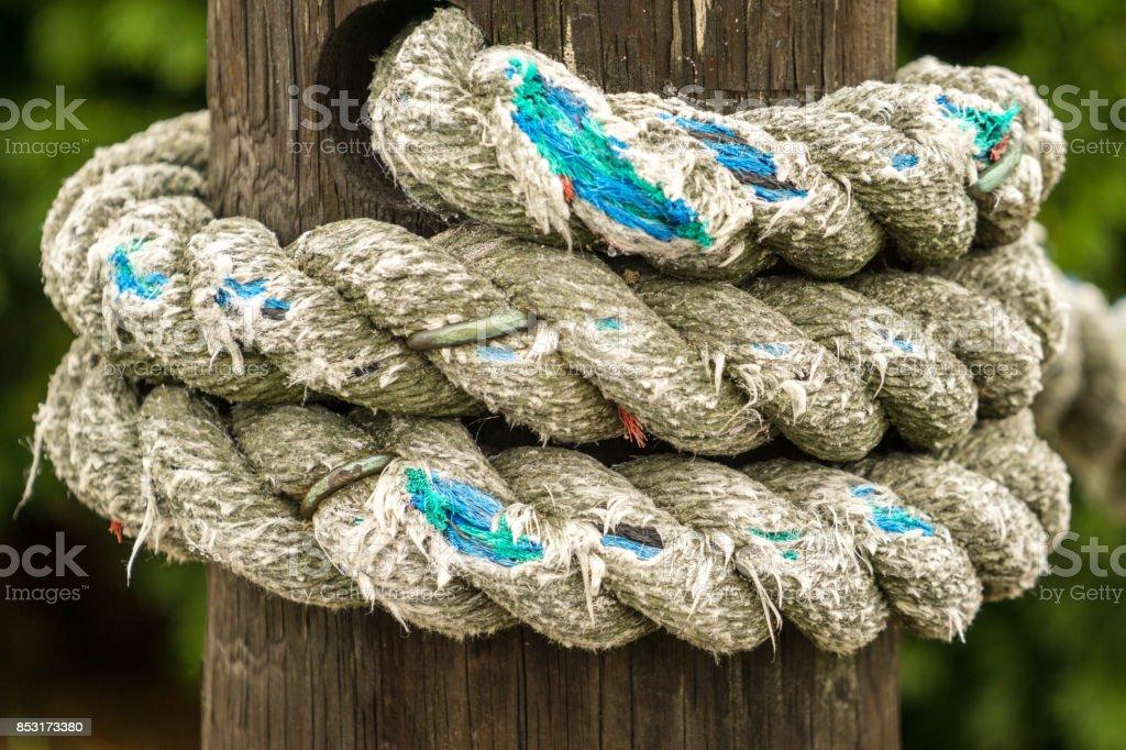 bollard and rope up close stock photo