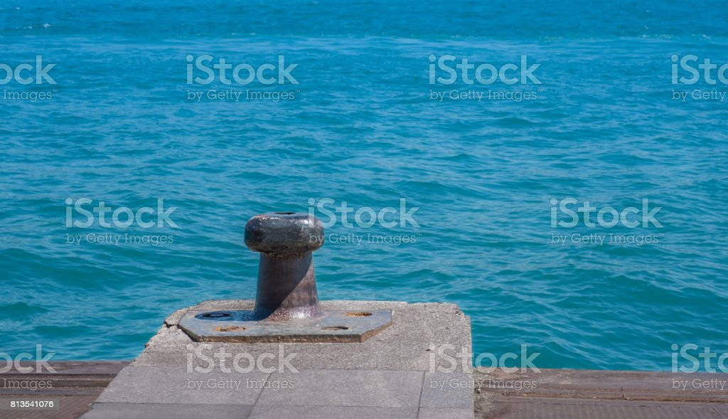 bollard, makefast, bollard and sea stock photo