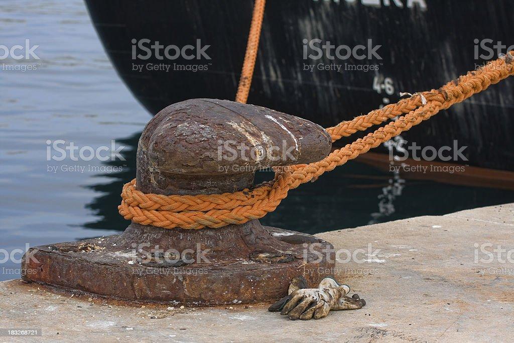 Bollard on a harbor pier stock photo