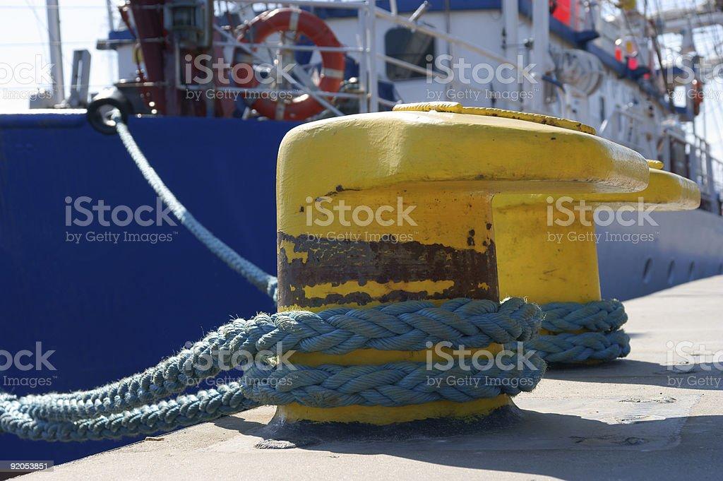bollard, port detail and ship royalty-free stock photo