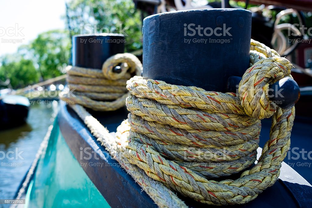 Bollard with a rope on ship stock photo