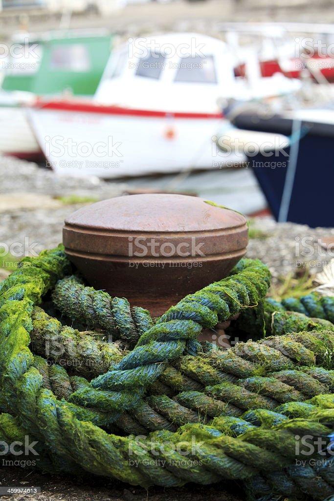bollard with green rope stock photo